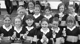 Up through the ranks: Just announced, Kerry ladies captain, Cáit Lynch (centre right) pictured as part of the winning Girls' U-10 football competition in the Castleisland Desmonds GAA Club Family Day on a Sunday afternoon in 2000. Included are front from left: Anna Bergin, Deirdre Doody, Aisling O'Connell, Cáit Lynch, Louise Joyce and Áine Connell. Back from left: Julieanne Twomey, Ciara Moriarty, Una Geaney, Julie Lombard, Ruth O'Connor and Gina Reidy. Photograph: Pat Hartnett 15-8-2000