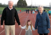 Matt and Nora Horgan pictured with their grand-daughter, Melissa at the Charity Mile fundraiser at An Ríocht AC in Castleisland on Christmas morning. Photograph: Niamh McSweeney