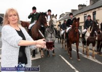 Publican, Kathleen O'Connor providing inner warmth for the Kerry Hunt Club members outside The Half Barrel on Sunday afternoon. ©Photograph: John Reidy