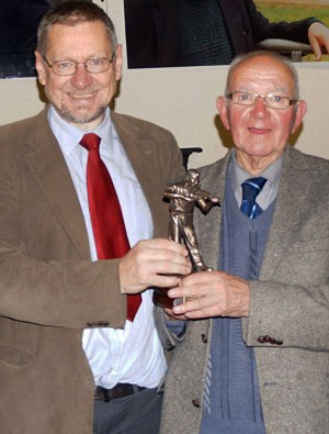 Festival founder member, broadcaster and piper, Peter Browne (left) presenting the 'Dedication' award to Killarney based singer, Jimmy O'Brien at the Patrick O'Keeffe Traditional Music Festival Sunday night concert at last October's event. Photograph: Paudie O'Connor
