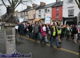 What would he think of it all. I think we know what he'd think. Marchers passing the bust of the late Con Houlihan during the Right2Water protest march in Castleisland this afternoon. ©Photograph: John Reidy