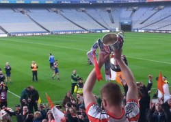 The Tangerine Dream Comes true as Brosna captain, Don McAuliffe lifts the cup after the game. Photograph: Erika Cronin