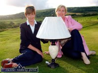 Castleisland Golf Club Lady Captain, Babs Kelliher (left) presents her prize to Marian O'Connor at Castleisland Golf Club on Sunday evening. The competition was played on Sunday, July 4-2004 ©Photograph: John Reidy 11/07/2004