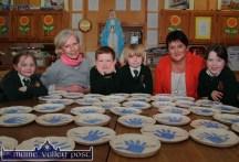 Happy with their plate production: Niamh O'Donnell,Marjorie Cunningham, potter; Kyle Buckley, Ryan Walsh Murphy, Mairéad Bn. Uí Bhrosnacháin,principal and Laura McShane at Scartaglin NS. ©Photograph: John Reidy