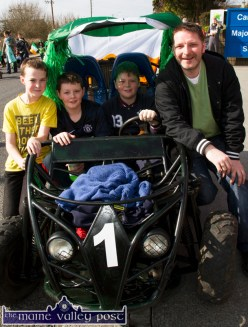 Making their way to the start of Tuesday's St. Patrick's Day Parade in their buggy were: Tomás McDonough (left) Alex, Luke and Eddie Regan. ©Photograph: John Reidy