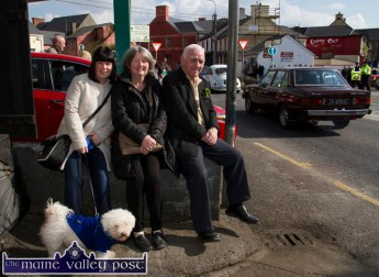 Watching the parade at Tralee Road on Tuesday were: Cateriona Hill with her aunt Eilish Conway and grand-dad, Michael Conway and Casper. ©Photograph: John Reidy