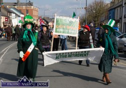 Beth Carty (left) and Josie Fallon leading the Castleisland Active Retirement group at Tuesday's St. Patrick's Day Parade in Castleisland. ©Photograph: John Reidy