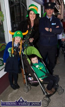 Jennifer and Garda Denis O'Mahony pictured with their children Lauren and Ronan At the annual St. Patrick's Day Parade in Castleisland on Tuesday afternoon. ©Photograph: John Reidy