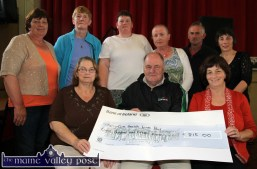 Seán Prendergast receiving a cheque on behalf of the Kerry - Cork Health Link Bus from the proceeds of the 2014 Carmel Linehan memorial Run / Walk committee at Knocknagoshel Community Centre. Making the presentation are: Bridget Scanlon (left) and Catherine Brosnan. Back from left: Catherine Brosnan, Mary McAuliffe, Catherine Browne, Eileen O'Connor, Nelius Linehan and Marie O'Callaghan. ©Photograph: John Reidy 15-8-2014