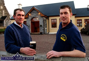 Cordal's first licenced premises proprietor, Sean Hughes filled the first pint from the taps for his father, Tom Hughes. The pub opened to the public on Friday evening at 5pm. ©Photograph: John Reidy 11-3-2005