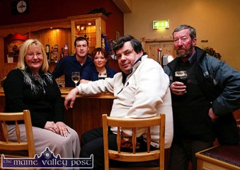 Among the first customers at the opening of Hughes Bar in Cordal on Friday evening were: Mary O'Connor, Dermot Horan, Castleisland and Johnny Cahill, Currow with proprietors, Sean Hughes and Moira O'Connor. ©Photograph: John Reidy 11-3-2005