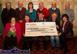 River Island Hotel Card Players and representatives of recipient groups pictured at the presentation of cheques before Sunday night's games. Front: Hannah Hickey, Pat O'Donnell, Donie Cremins, Johnny Healy and Mary Shanahan. Back row: Frank Moran, Dom O'Donnell, Kathleen Herlihy, John Skevena O'Sullivan, Ted Moynihan and John O'Connell. ©Photograph: John Reidy