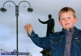 Four year old Bones Playing Champion, John William Forde from Abbeyfeale pictured beside the famous Fr. Casey landmark in the town's square. ©Photograph: John Reidy 05/05/2004