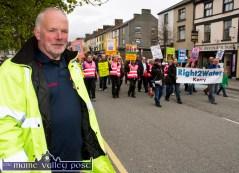 Event co-ordinator, John O'Sullivan steering the Right2Water Castleisland protest march through Main Street on Saturday afternoon. ©Photograph: John Reidy