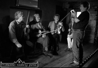 Broadcaster and musician, Philip King getting behind the camera and capturing: Johnny McCarthy, Paddy Cronin, Nicky and Anne McAuliffe at the shooting of the Sé mo Laoch programme on Paddy Cronin at Tom Fleming's Bar in Scartaglin. ©Photograph: John Reidy 19-6-2002