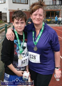 Thrilled with their achievement after the 2014 event were: Conor O'Sullivan and his mom, Michelle after their Couch-to-5K run during the An Riocht AC / Lee Strand Kingdom Come 10 Miler Road Race in Castleisland. ©Photograph: John Reidy