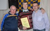 Chairperson of Cordal GAA Club, Tom Wrenn and club secretary, Richard O'Donoghue congratulate Dermot (Big D) Flynn on his special night. Photograph: John Reidy