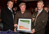 Michael Vallely, Asdee (centre) won the raffle for a framed poem about the events of July 10-1921 in Castleisland. The presentation was made by Cllr. Pa Daly (left) and Denny McSweeney, chairman of the organising Bonn/Doherty Cumann at the River Island Hotel on Friday evening. The poem had been collected and preserved by the late Jerry Savage, Ballymacelligott. ©Photograph: John Reidy