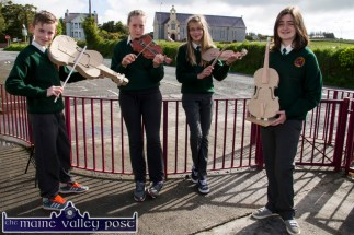 Scartaglin National School pupils, Cian Walsh-Murphy, Gráinne Walsh, Olga O'Sullivan and Rachel O'Connell displaying their model fiddles in preparation for their exhibition at the village heritage centre for next weekend's World Fiddle Day celebrations. ©Photograph: John Reidy
