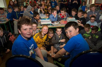 No going back now: Luke and Conor take their hot seats in front of fifth and sixth classes just before they lost their heads of hair at their Shave or Dye performance at Gaelscoil Aogáin on Friday. ©Photograph: John Reidy