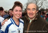 A beaming Eilísh Lynch is greeted by Séamus Falvey her former principal at St. Joseph's Presentation School after the All-Ireland Intermediate final in Corofin on Saturday afternoon. Photo by John Reidy