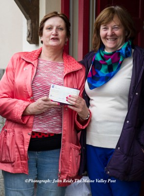 Worth the wait: Vigil holder, Dolores Shanahan-Lynch showing her deposit with support from her cousin, Joan Walsh at Cahereen Heights this morning. ©Photograph: John Reidy