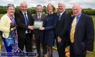 A proud moment for Cordal GAA Club PRO, Nora Fealey (left) as Charlie Farrelly presents her framed photograph of the re-opened field and facilities to Frances Farrell with her husband, Aogán Ó Fearghail, Uachtarán Chumann Lúthchleas Gael in the presence of: Seán Kelly, MEP and Tom Wrenn, Chairman Cordal GAA Club at the reopening ceremony on Sunday. ©Photograph: John Reidy
