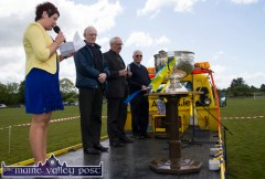 Cordal GAA Club treasurer, Bríd Wrenn delivering her cupla focal in the presence of: Fr. Seán Horgan, Monsignor Dan O'Riordan and Canon Denis O'Mahony at the re-opening of Cordal GAA Club grounds on Sunday afternoon ©Photograph: John Reidy