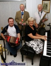 Compere, Donacha Ó Duilaing (back left) pictured with entertainers: Seán Hickey from Scartaglin on accordion with pianist, Helen Lyons and saxophonist, Tommy Watson at Divane's 50th anniversary celebrations in June 2005. ©Photograph: John Reidy 17/06/2005