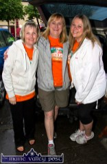 Organising committee members: Noreen Kerins (left) with Gina Fagan and Norma Moran taking shelter from the 6-30am downpour at the start of the second annual Longest Day Cycle/Climb/Cycle Challenge in Castleisland on Saturday morning. ©Photograph: John Reidy