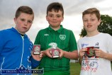 The Boys with the Borrowed Medals: Not wanting to be outside the winners' enclosure, Shane Coffey, Conor O'Neill and Evan Murphy craftily borrowed three medals for this photograph after the annual Castleisland KDYS / Garda Soccer League. ©Photograph: John Reidy