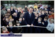 International Rugby hero Mick Galwey surrounded by a horde of enthusiastic neighbours as he cuts the tape to officially open the Kileentierna Wildlife Park in his native village of Currow. ©photograph: John Reidy 18-12-2000