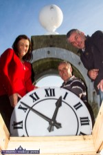 Helen O'Connell with her brothers, Tommy and Neil Hickey removing the old clock-face from The Market House tower on Wednesday morning. ©Photograph: John Reidy