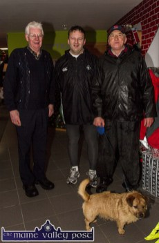 Joe (left) and Tommy Martin pictured with Philip Horan and Buster at the annual GOAL Mile at An Riocht AC on Christmas Morning. ©Photograph: John Reidy