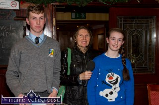 Castleisland students, Brian Shanahan and Paris McCarthy pictured with Mary Fagan at the launch of the Castleisland Parish Magazine at the River Island Hotel. ©Photograph: John Reidy
