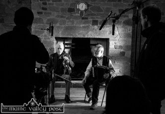 After the Angelus: Matt Cranitch and Jackie Daly in a pause in the recording of the Sé Mo Laoch special on Jackie at the Scartaglin Heritage Centre on Monday with TG4 / Sibéal Teo crew members: Cathal Watters and Ciarán Ó Maonaigh. ©Photograph: john Reidy