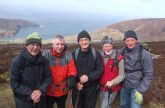 Before the Storm: The Castleisland pilgrims from left: Billy O'Rourke, Jack Nolan, Tadhg McGillicuddy, Tony O'Callaghan and Mikey O'Connor pictured on Cnoc Na dTobar on Good Friday. Photograph: Courtesy of Mikey O'Connor