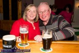 The late Tom Wrenn posing with neighbour, Bridget Mannix at the cheque presentation evening at Hughes' Bar after the Movember 2015 fundraiser. ©Photograph: John Reidy 2-12-2015