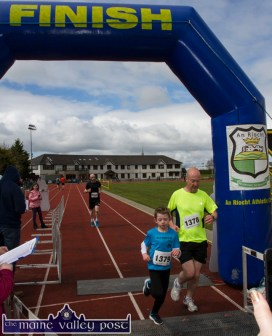 John Walshe and his son, Zach of St. Brendan's AC, Ardfert just finishing the annual An Riocht AC / Lee Strand Kingdom Come 10 Miler and 5K Road Race in Castleisland this morning. ©Photograph: John Reidy