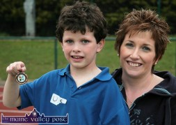 A happy John O'Connor pictured with his mom, Bríd Ann and his U-8 medal at the 2010 Currow / Currans Community Games finals at An Riocht AC Stadium in Castleisland. ©Photograph: John Reidy 28-5-2010