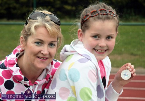 Happiness is...: Katie McCarthy pictured with her mom, Kathleen and her U-10 medal after the 2010 Currow / Currans Community Games finals at An Riocht AC Stadium in Castleisland. ©Photograph: John Reidy 28-5-2010