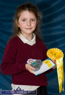 Maja Moskal with her painting on stone and her prizes from the Kingdom County Fair Art Competition. ©Photograph: John Reidy