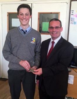 Paul Walsh receives his Contribution and Diligence Award from St. Patrick's Principal Denis O'Donovan.