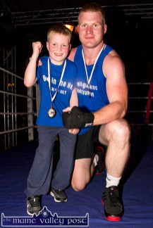 A proud Noah Fitzgerald with his dad, Pat after his bruising encounter with Kieran Downey.