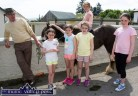 Local man, Anthony McAuliffe and his pony were a great attraction for: Niamh, Shannon and Clodagh Collins, Ella and Hazel Murphy at the annual Knocknagoshel Horse Fair. ©Photograph: John Reidy