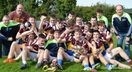 All smiles from Cordal/Scart East Kerry League Division 2 Champions with mentors: Martin Hewitt, Pat O'Shea and Tommy O'Connor. Photograph: CúlPix/Nora Fealey 2016©