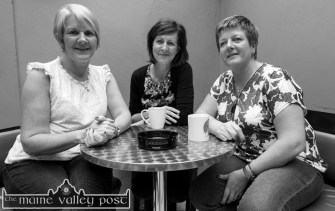 Bridget Reidy, Kearney's Bar (left) pictured with Sheila Hayes, Jack & Jill Foundation and Betty O'Connell, Kearney's Bar restarting on the empty coffee/tea jar after the cheque presentation to the Jack and Jill Foundation. ©Photograph: John Reidy