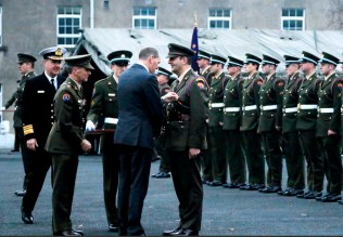 Commandant Tommy Martin being presented with his medal by Paul Kehoe, Minister for Defence at the ceremony at Sarsfield Barracks in Limerick.
