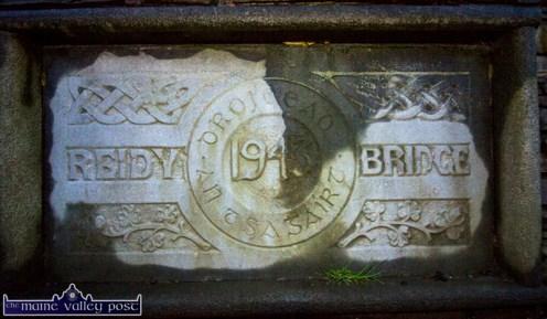 The plaque on Dean Reidy Bridge or Droichead an tSagairt built in Currow in 1943. ©Photograph: John Reidy