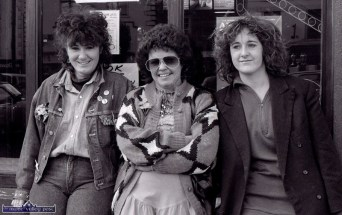 Jane Thomas (centre) with sisters, Louise (left) and Bernadette Cremins watching the at the first St. Patrick's Day Parade in Castleisland. ©Photograph: John Reidy 17-3-1989